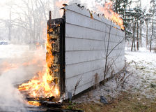 House Fire. A house on fire burns completely to the ground royalty free stock photo