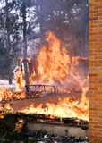 House Fire. A house on fire burns completely to the ground royalty free stock photos