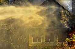 House on Fire in Evening royalty free stock photos