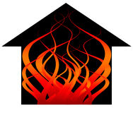 House fire with flames. A black building consumed by flames in a fire for fire risk, assessments of risk, and building and contents home or business insurance Royalty Free Stock Photography