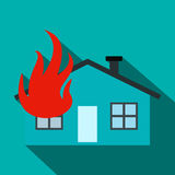 House on fire flat icon. On a blue background Stock Image