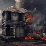 House on fire. Gloomy landscape with an old ruined house on fire Stock Image