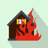 House on fire icon, flat style. House on fire icon in flat style on a light blue background Royalty Free Stock Image