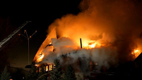 House on fire. Inferno conflagration. House building on fire at night. Inferno conflagration Royalty Free Stock Photo