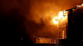 House on fire. Inferno conflagration. House building on fire at night. Inferno conflagration Royalty Free Stock Images