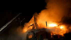 House on fire. Inferno conflagration. House building on fire at night. Inferno conflagration Stock Photos