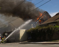 House fire in Mill Valley. House is consumed in fire in Mill Valley, California Royalty Free Stock Photography