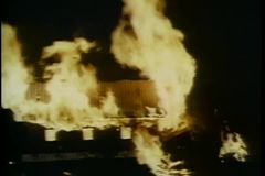 House on fire at night stock footage