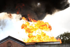 House on Fire. Residential House on Fire with flames Royalty Free Stock Image