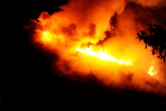 House in fire. House under construction caught fire by night Royalty Free Stock Image