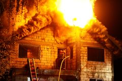 House in fire Stock Photos