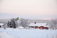 House with flag in Lapland Stock Images