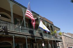 House with flags in French Quarter New Orleans. Louisiana USA royalty free stock photos