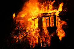 House in flames Stock Images