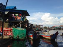House in the floating village. Fisherman boats. Tonle Sap lake, Cambodia. royalty free stock photo