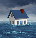 House Flood. Insurance concept with a generic residential home damaged during a flooding disaster by severe weather or hurricane causing environmental damage Royalty Free Stock Images
