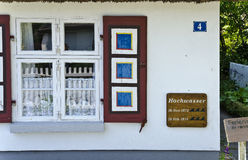 House with flood marks. And colorful window shutter at Zingst, Germany stock images