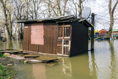 House in flood. River house boat in flood stock photos