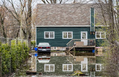 House Flood. River flood inundated a house beside a river royalty free stock images