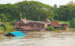 House flood in Thailand. Flood waters overtake house in Thailand royalty free stock image