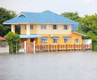 House flood in Thailand. Flood waters overtake house in Thailand royalty free stock photos