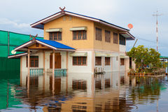 House flood in Thailand. Flood waters overtake house in Thailand stock image