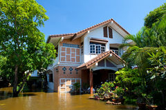 House flood in Thailand. Flood waters overtake house in Thailand stock photography