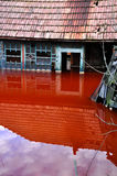 House flooded by contaminated water from a copper open pit mine. Ecological disaster. A house flooded by contaminated water from a copper open pit mine stock photos