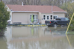 House flooded in Spring. A home in Gatineau, Quebec, Canada is flooded during the Spring flood of 2017. Sand bags have been placed around the home to protect it stock photos