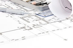 House floor plan blueprints and drawing tools closeup. House floor plan blueprints and drawing tools macro view royalty free stock photography