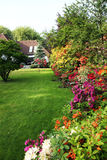 House with flower garden. The villa is visible in the background text space Royalty Free Stock Photos
