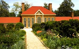 House and Flower Garden. Lovely flower gardens at Mt. Vernon, Virginia with the greenhouse in the background stock photos