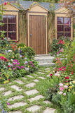 House with flower garden Royalty Free Stock Image