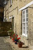 House with flowerpots, Burford, England Stock Photo