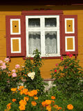 House and flowers. Small house and flowers in north Poland - Żuławy royalty free stock photography