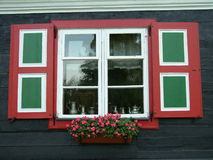 House and flowers. Old house and flowers in north Poland - Żuławy stock photography