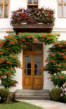 House with flowers in the garden stock photography