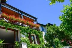 Sirmione on lake Lago di Garda, Italy. House with flowers in old town Sirmione on lake Lago di Garda stock photos