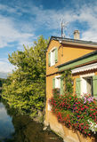 House with flowers in windows Royalty Free Stock Images