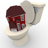 House Flushing Down Toilet - Falling Home Values Royalty Free Stock Photography
