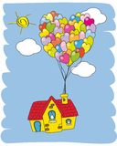 House flying with balloons