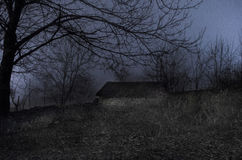 House in fog at night in the garden, Landscape of ghost house in the dark forest. Stock Photo