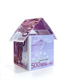 House of folded Euro banknotes. House of folded five hundred Euro banknotes, isolated on white background Stock Image