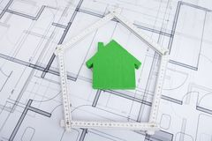House in folding ruler on blueprint royalty free stock photography