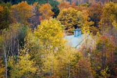 House in Foliage. Fall Foliage and House in Rural New England Stock Photo