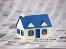 House Foreclosed in Newspaper. House Foreclosed on top of classifieds Newspaper Stock Images