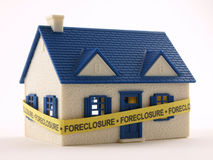 House with Foreclosure tape. House wrapped with Foreclosure tape front view Stock Images