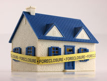 House with Foreclosure tape ground view Royalty Free Stock Image