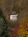 House in a forest. Old house surrounded by autumn trees stock photos