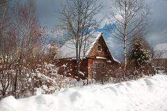 House in forest. Winter sky clouds Stock Photos